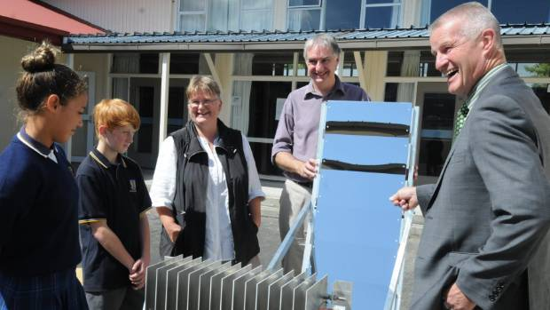 Principal Andy Fraser, right, with Energise Otaki convenor Gael Ferguson, Sunrayker technologist Andrew Clark, and ...