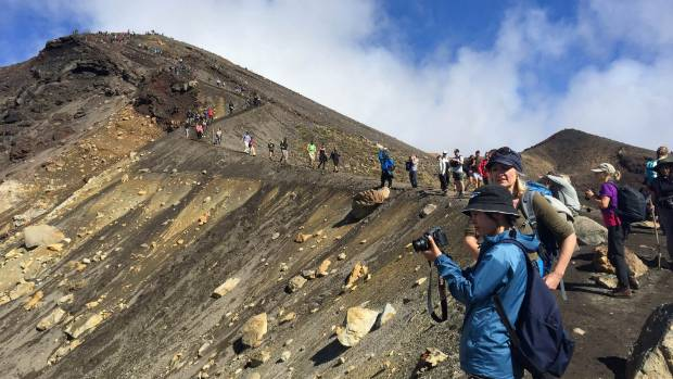 Tourists stream across the busy Tongariro Crossing on Easter Sunday, when queues for toilets stretched to the dozens.