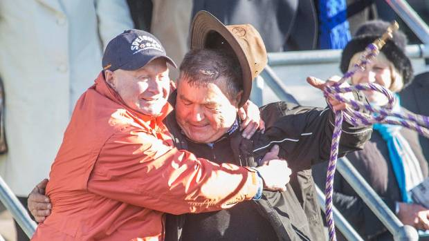 "Three Star Syndicate member Michael ""Moon"" Prince celebrates with Miss Three Stars' trainer Tommy Beckett."