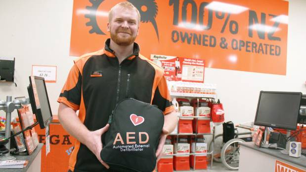 Albany Mega Mitre 10 manager Garyth Murray with the store's AED,