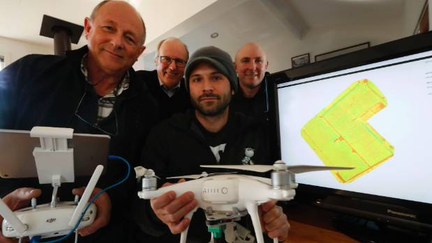 The DroneMate team Axel Knauer, left, John Bamfylde, Jonathan Lopardo and Geoff Sherlock with one of their drones and an ...