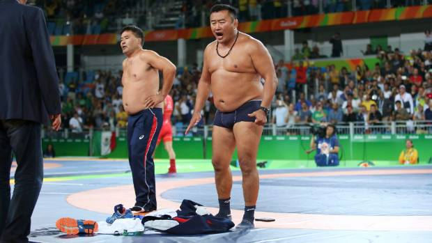 Mongolian coaches strip down in protest after their wrestler was denied bronze at the Rio Olympics.
