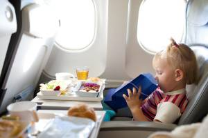 Mum says she is sick of people complaining about kids on flights and claims that's why business class exists.