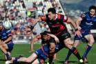Canterbury midfielder Rob Thompson offloads in the tackle of Tasman halfback Finlay Christie in the build up to Jordie ...
