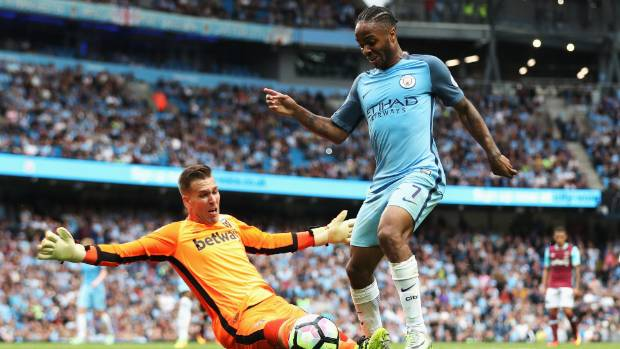 Manchester City's Raheem Sterling rounds West Ham goalkeeper Adrian.