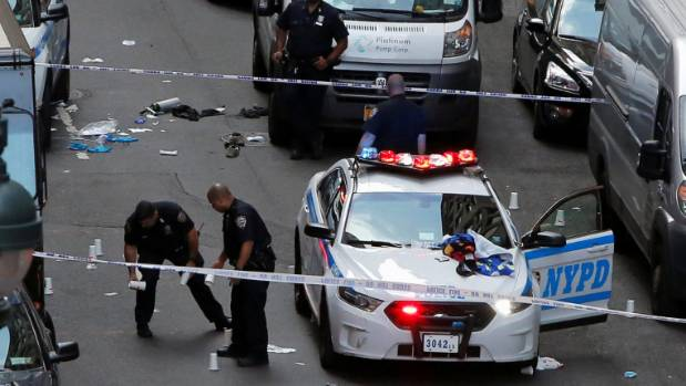 Police investigate the scene where a man was shot by police in Manhattan. Officers reportedly fired 18 shots at the ...