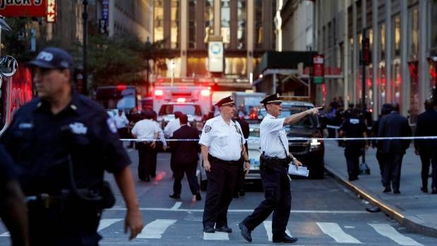The New York police commissioner says the man was waving a 30cm-long cleaver.