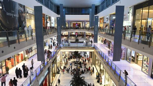 Dubai Mall has more than 1,200 stores, a 22-screen movie theatre with 2,800 seats, a copy of London's famous Regent ...