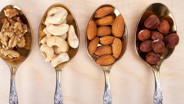 Eating a handful of nuts a day has been shown to lower your risk of heart disease by 30 to 50 per cent.