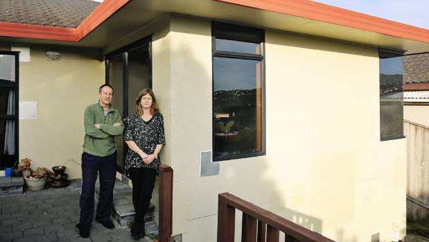 Tracey Cridge and Mark Unwin outside their leaky Wellington home, which they believe is due to the use of HardieTex.