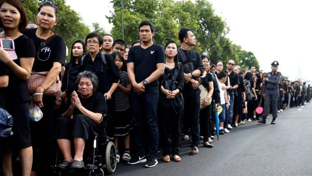 Mourners gather outside the Grand Palace to pay their respects to the late King Bhumibol Adulyadej in Bangkok.