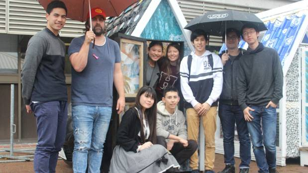 University of Auckland Architecture design lecturer Matt Liggins, second from left, with students who helped construct ...