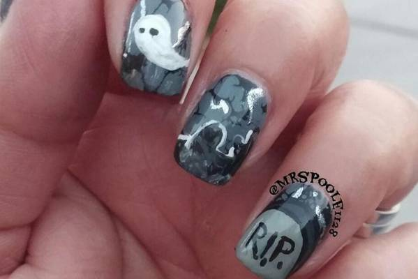 Greys, whites and blacks mixed together make these nails moody and mysterious.