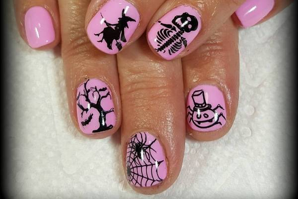 Baby pink and black never looked so scary. Invest in a fine brush to really nail these designs.