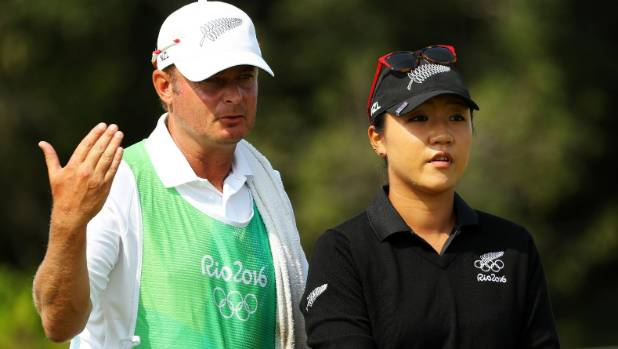 Lydia Ko's caddy Jason Hamilton hands out advice during the Rio Olympics where the world No 1 won a silver medal.