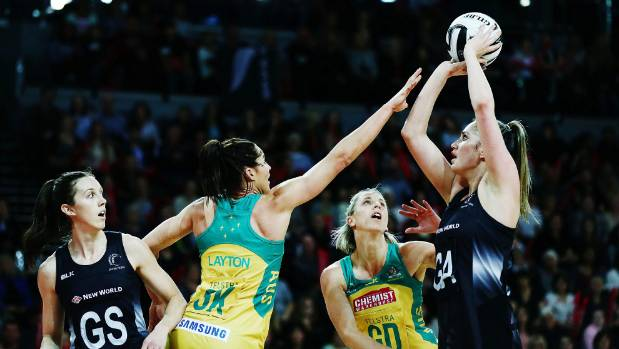 Te Paea Selby-Rickit of New Zealand shoots over Clare McMeniman and Sharni Layton of Australia.