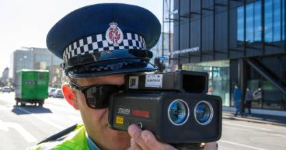 Police monitoring the speed limits of road users.