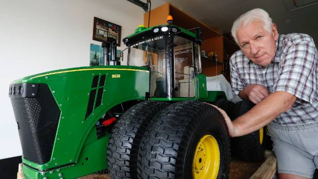 Brian Bickmore with a 95kg radio controlled model John Deere tractor he built by hand.