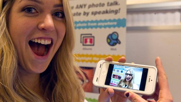 Gillian Pennington holds a smartphone with an animated, speaking image of herself in the Freak 'n Genius booth during ...
