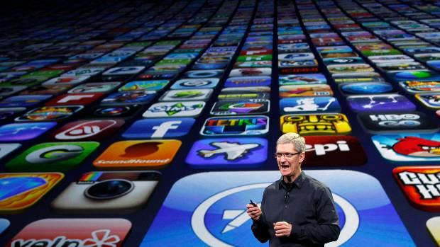 CEO Tim Cook speaks about the number of Apps downloaded during an Apple event in San Francisco, California.