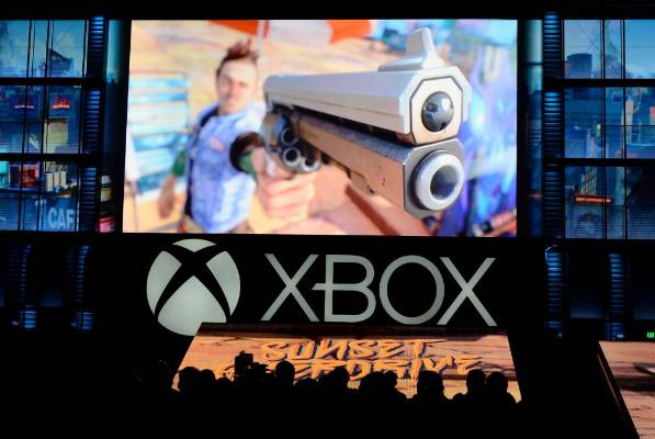 Attendees watch a scene from the game Sunset Overdrive during the Xbox E3 Media Briefing at USC's Galen Center in Los ...