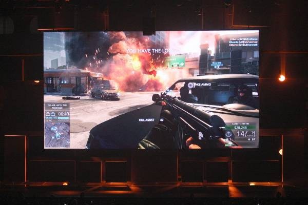 A Los Angeles street battle scene in the beta version of Battlefield: Hardline is shown at the EA World Premiere: E3 ...