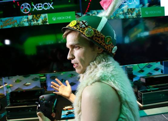 Brandon Winfrey, a developer with Insomniac Games, demonstrates the Sunset Overdrive game at the 2014 Electronic ...