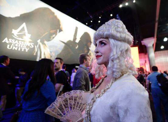 A woman dressed as Marie Antoinette to promote  Assassin's Creed: Unity at the Ubisoft booth at E3 2014.