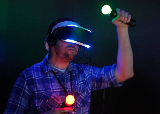 A man tries out Sony's Project Morpheus virtual reality system at the 2014 Electronic Entertainment Expo.