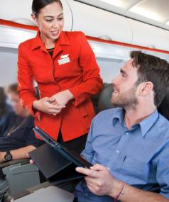 "BRING YOUR OWN: 87 per cent of travellers believe the ""bring your own device"" policy saves airlines money and want ..."