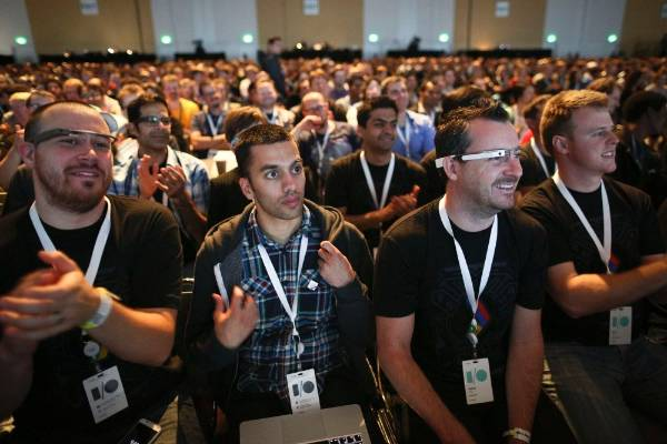 Attendees, some wearing Google Glass, watch a keynote address at the Google I/O developers conference in San Francisco.