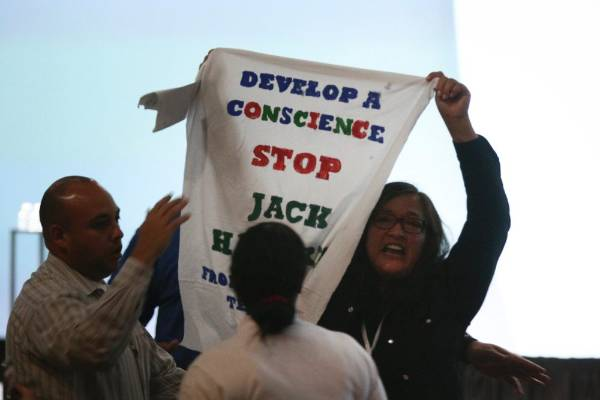 A protester chanting 'Google, develop a conscience' disrupts Google's Engineering Director Dave Burke's speech during ...