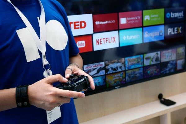 Sascha Prueter uses a game controller to demonstrate the features of the newly-announced Android TV at the Google I/O ...