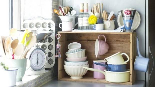 A small wooden crate adds personality to a bleak kitchen - as well as added storage.
