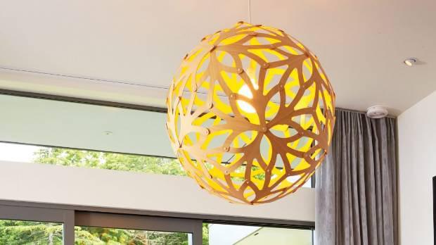 A statement pendant over an exposed bulb produces a personalised feel to a room.