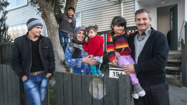 Syrian refugees Yassin Ibrahim Ashira and his family at their home in Porirua. From left: Maher, 16, Mazen, 12, wife ...